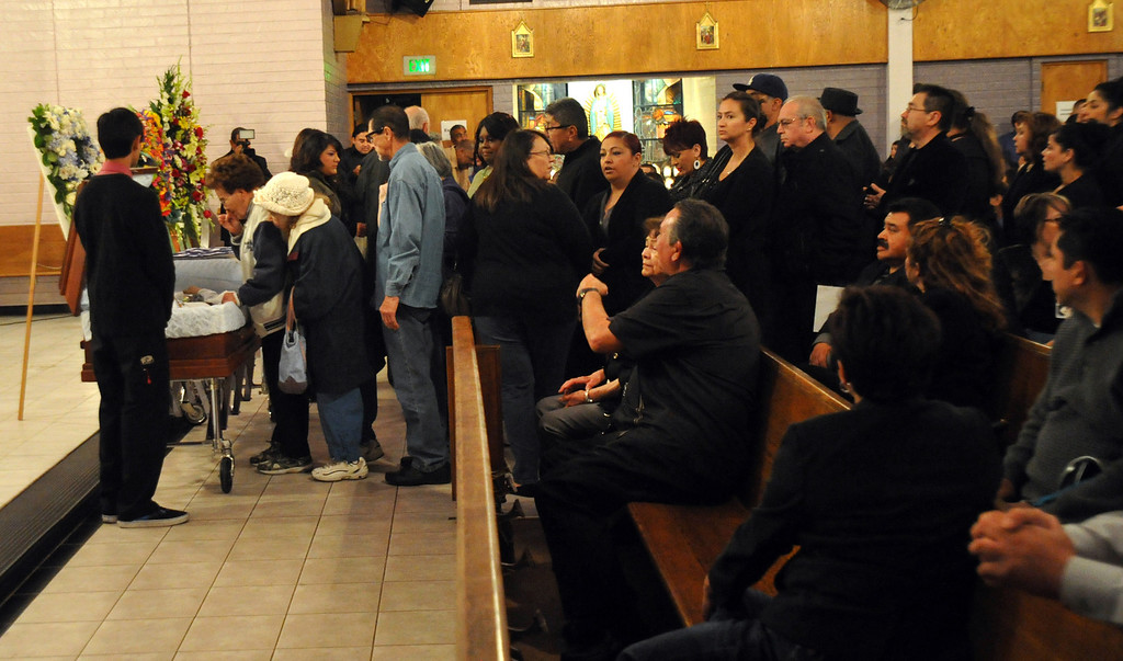 Description of . Mourners gather to remember restaurant owner Manuel Rojas during the Rosary service at Assumption Church in Boyle Heights on February 25, 2013. Rojas, owner of Manuel's Original El Tepeyac Cafe, he was known for making the famous