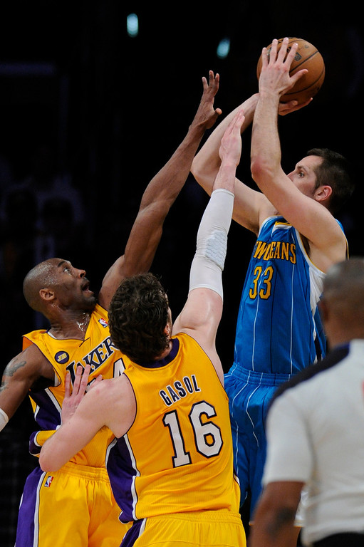 . Kobe Bryant and Pau Gasol team up to block a shot by Hornets Ryan Anderson in the final moments.  The Lakers defeated New Orleans Hornets 104-96 in a game played at Staples Center in Los Angeles, CA 4/9/2013(John McCoy/Staff Photographer