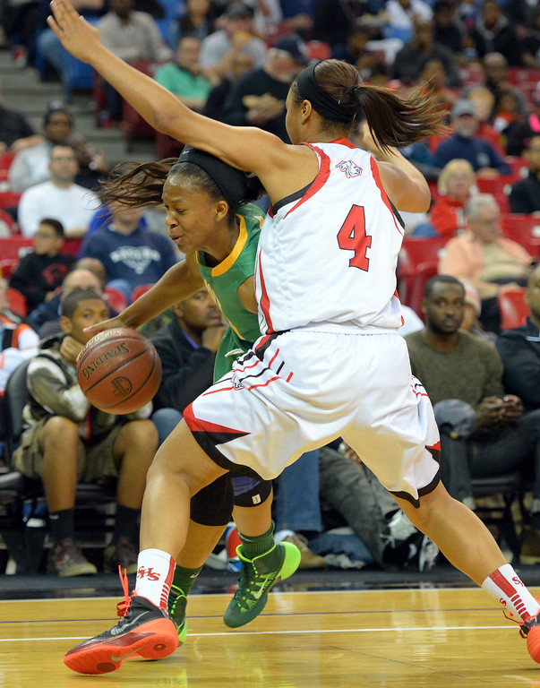 . Poly\'s Lajahna Drummber drives around Salesian\'s Mariya Moore at Sleep Train Arena in Sacramento, CA on Saturday, March 29, 2014. Long Beach Poly vs Salesian in the CIF Open Div girls basketball state final. 1st half. (Photo by Scott Varley, Daily Breeze)