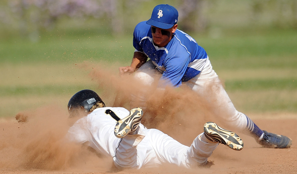Description of . Northview's Gabe Rojo (1) safe at second base ahead of the tag by Baldwin Park shortstop Jonatan Huerta in the fourth inning of a prep baseball game at Northview High School on Tuesday, April 23, 2012 in Covina, Calif. Northview won 8-2.    (Keith Birmingham/Pasadena Star-News)