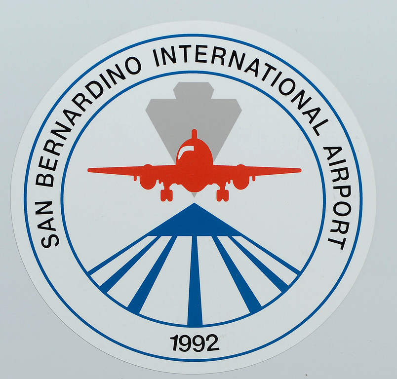 Description of . A view the logo for the San Bernardino International Airport March 28, 2013.  Built on the former the site of the former Norton Air Force Base, is often described by local officials as one of the East Valley's best hopes for economic growth. Norton closed in 1994.  GABRIEL LUIS ACOSTA/STAFF PHOTOGRAPHER.
