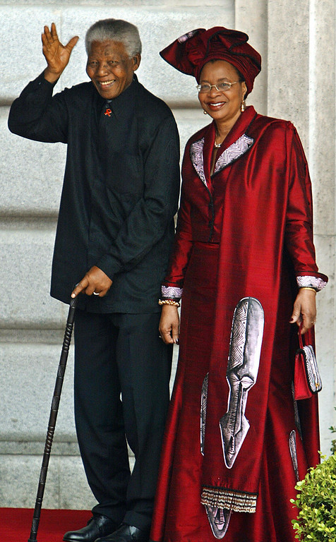 . MADRID, Spain:  Former South African President Nelson Mandela and his wife Graca Machel smile to photographers as they arrive at Madrid\'s Almudena Cathedral to attend Spanish Crown Prince Felipe of Bourbon\'s wedding to former journalist Letizia Ortiz 22 May 2004.  (PIERRE-PHILIPPE MARCOU/AFP/Getty Images)