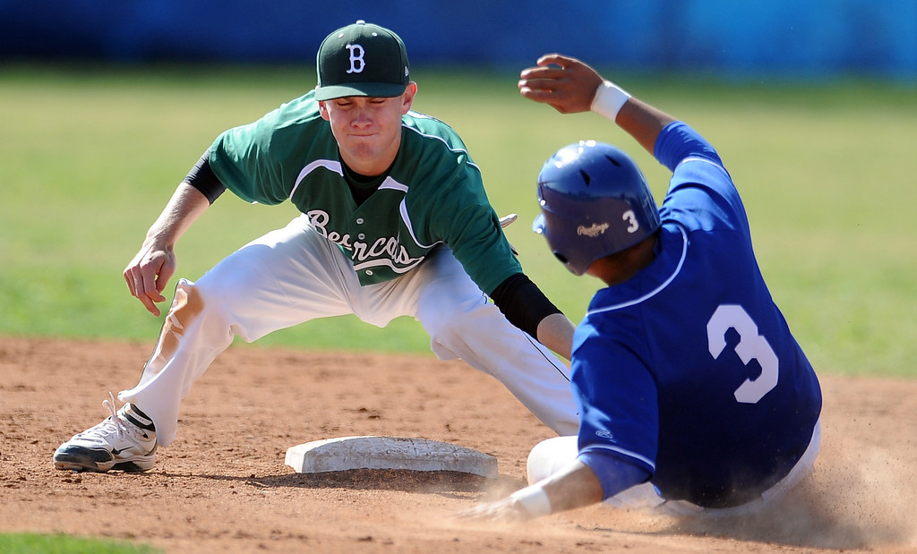 . Bonita second baseman Austin McGilvra tags out La Habra\'s Marcus Lopez (3) in the fourth inning of a prep baseball game at La Habra High School on Tuesday, April 2, 2013 in La Habra, Calif. Bonita won 8-2.  (Keith Birmingham Pasadena Star-News)