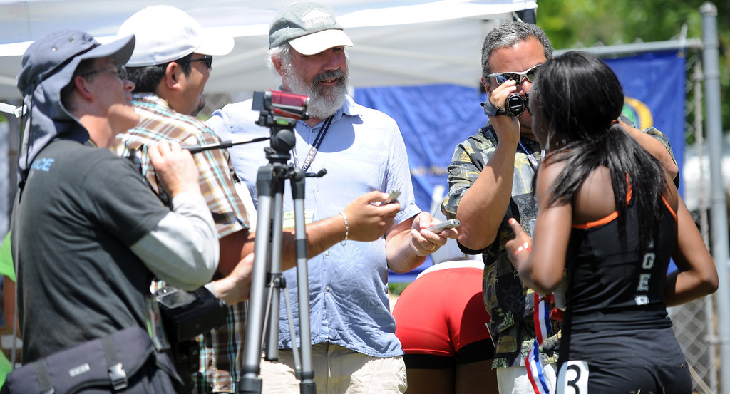 Description of . Reporters interview Laura Anuakpado, right, of South Pasadena during the Mt. SAC Relays in Hilmer Lodge Stadium on the campus of Mt. San Antonio College on Saturday, April 20, 2012 in Walnut, Calif.    (Keith Birmingham/Pasadena Star-News)