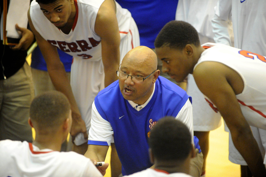 . 03-12-2013--(LANG Staff Photo by Sean Hiller)-Pacific Hills beat Serra 53-50 in Tuesday\'s boys basketball IV Southern California Regional semifinal at L.A. Southwest College. Coach  Dwan Hurt huddles with his team second half.