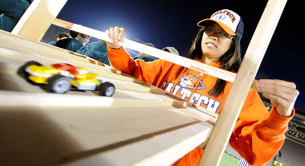 Description of . Caltech student Pukei Cheng test her lego car during the the 2013 Collegiate Field Tournament at the Rose Bowl on Friday, April 5, 2013 in Pasadena, Calif.  (Keith Birmingham Pasadena Star-News)