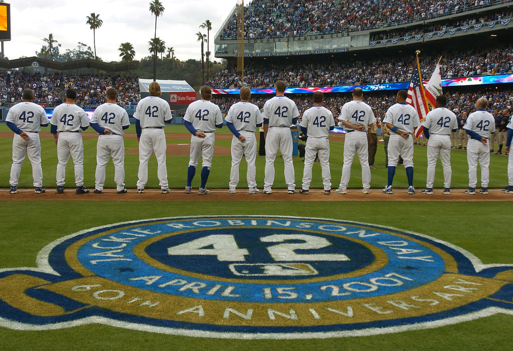 Description of . Dodger players all wear #42 on their jerseys in honor of Jackie Robinson at Dodger Stadium against the San Diego Padres, Sunday April 15, 2007. (Michael Owen Baker/Los Angeles Daily News)
