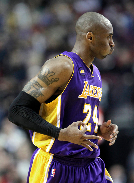 . Los Angeles Lakers guard Kobe Bryant holds out three fingers after hitting a three point shot during the second half of an NBA basketball game against the Portland Trail Blazers in Portland, Ore., Wednesday, April 10, 2013.  Bryant scored 47 points as the Lakers won 113-106.(AP Photo/Don Ryan)