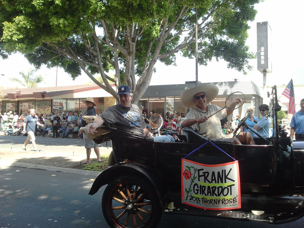 """. Pasadena Star-News Editor Frank Girardot was named by Doo Dah as this year\'s \""""Thorny Rose\"""" for generating controversy in the local community. Parade goers threw tortillas and silly string at participants of the parade on E. Colorado Boulevard (SGVN/Staff photo by Brian Day)"""