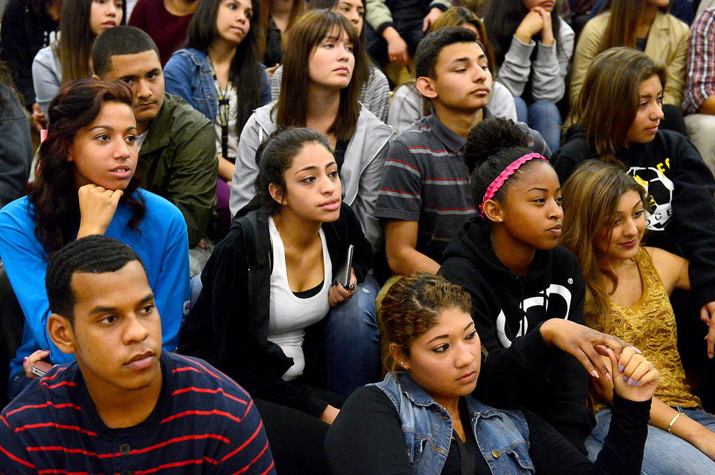 Description of . Students listen to motivational speaker Keith Hawkins  at Santa Fe High School Tuesday morning, March 19, 2013 as the Santa Fe Springs school holds their 23rd annual Diversity Summit this week. (SGVN/Staff Photo by Sarah Reingewirtz)