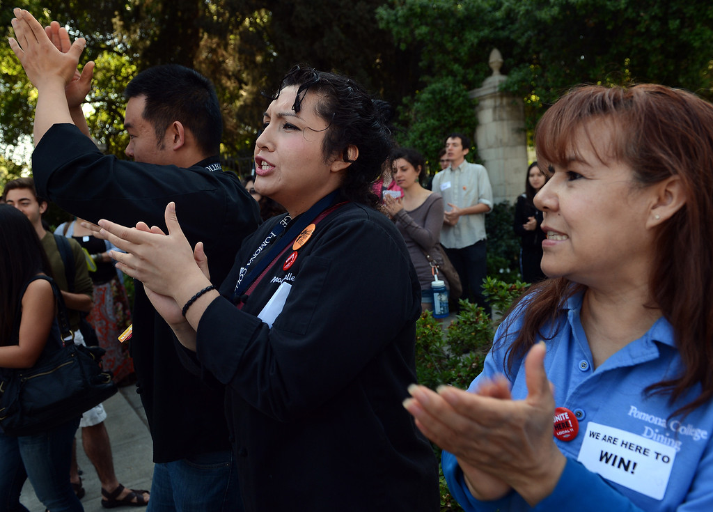 Description of . 0404_NWS_IDB_L-RALLY-01-JCM (Jennifer Cappuccio Maher/Staff Photographer) Pomona College dining hall workers Edward Mac, left, Crystal Flores and Olivia Marquez rally with students after announcing their plan to file for a union election Wednesday, April 3, 2013, at Pomona College in Claremont.