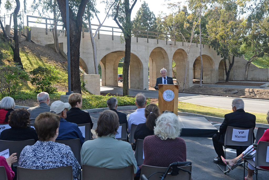 . The Torrance historical railroad bridge was rededicated and renamed the Pacific Electric Railway El Prado Bridge in a ceremony Thursday.  Councilman Tom Brewer speaks at the ceremony with the bridge in the background. 20130523 Photo by Steve McCrank / Staff Photographer