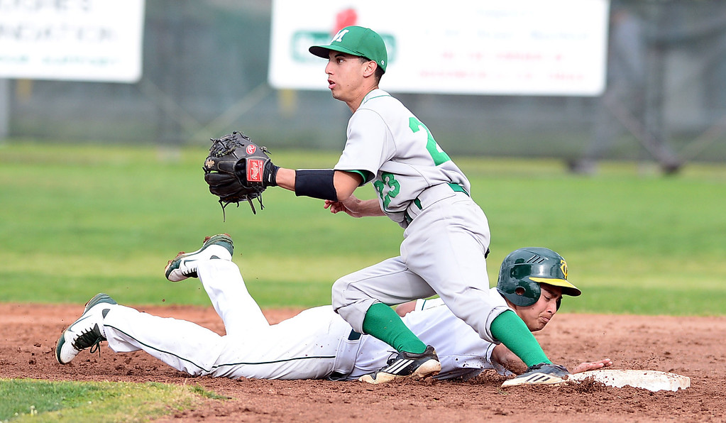. Monrovia\'s David Perez (23) attempts to out Temple City\'s Anthony Valencia (4) as he safely slides back to second  during the Arcadia Elks Tournament Thursday, March 7, 2013 at Temple City High School.  (SGVN/Staff Photo by Sarah Reingewirtz)