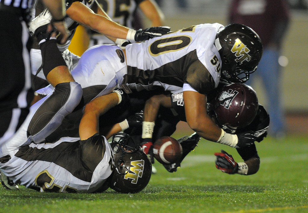 . West High takes on Torrance in a non league football game at Zamperini Stadium in Torrance, CA on Thursday, September 12, 2013. West\'s Ray Lima (50) and Jimmie Girardini tackle Bobby Wilson for a loss. (Photo by Scott Varley, Daily Breeze)