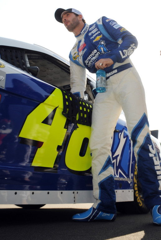 . (Will Lester/Staff Photographer) Jimmie Johnson exits his race car after qualifying Friday. NASCAR driver Denny Hamlin won the pole position for Sunday\'s Auto Club 400 Friday March 22, 2013. Hamlin lapped the 2-mile super speedway in 38.410 seconds at an average speed of 187.451mph.