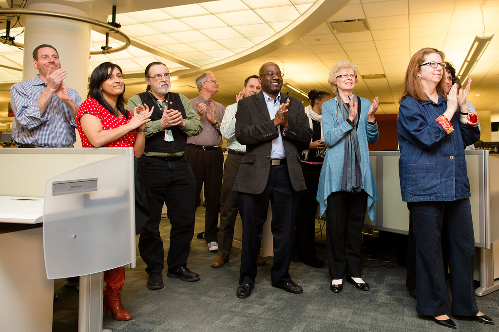 . Members of the Associated Press Headquarters newsroom applaud the announcement of the 2013 Pulitzer Prize winners Monday, April 15, 2013, in New York. Associated Press photographers Rodrigo Abd, Manu Brabo, Narciso Contreras, Khalil Hamra, and Muhammed Muheisen won the 2013 Pulitzer Prize for Breaking News Photography for their work covering the Syrian civil war. (AP Photo/John Minchillo)