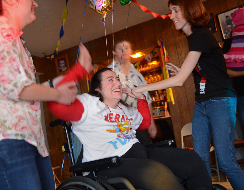 . Friends gather to dance with Olivia at her 25th birthday, held in her Torrance home. Music and dancing bring her a lot of joy. Photo by Brad Graverson/LANG 1-26-13
