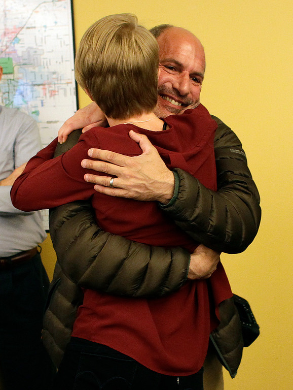 . Denver Post staff photographer Craig Walker, facing, hugs colleague breaking news reporter Jordan Steffen, after the announcement that The Denver Post Staff had won a Pulitzer Prize for Breaking News, inside the newsroom of the Denver Post, in Denver, Monday April 15, 2013. The Post won for their comprehensive coverage of the shooting massacre at an Aurora, Colorado movie theatre in July 2012. (AP Photo/Brennan Linsley)