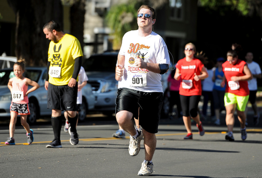 . Runners participate in the 30th annual Run Through Redlands event on Sunday, April 21, 2013. The race proceeds benefited the Kiwanis Club Foundation and scholarship opportunities for high school seniors. (Rachel Luna / Staff Photographer)