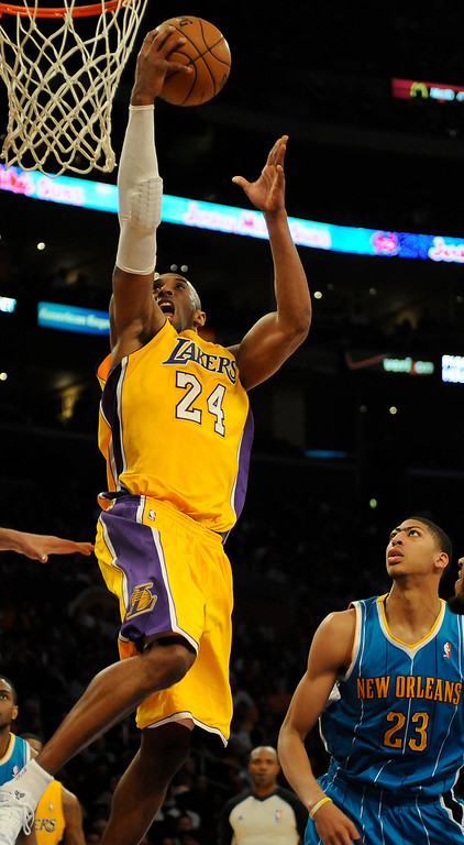 . Lakers#24 Kobe Bryant is fouled on his way to the hoop in the 4th quarter. The Lakers defeated New Orleans Hornets 104-96 in a game played at Staples Center in Los Angeles, CA 4/9/2013(John McCoy/Staff Photographer