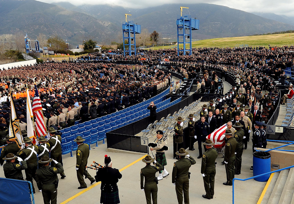 Description of . A scene from memorial services for San Bernardino County Sheriff Deputy Jeremiah MacKay at the San Manuel Amphitheater in Devore February 21, 2013.  GABRIEL LUIS ACOSTA/STAFF PHOTOGRAPHER.