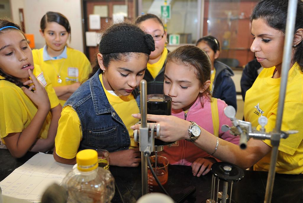 . 3/15/13 - L-R Fifth graders, Soe Avila and Valerie Cadena watch as graduate student Hina Bhatia shows them how to measure the velocity of ketchup. The girls were on campus for the Cal State Long Beach�s (CSULB) annual �Engineering Girls at the Beach.�  The event hosts some 250 high school, middle school and elementary school girls and boys for an understanding of engineering, computer science, technology and other non-traditional career fields. Photo by Brittany Murray / Staff Photographer