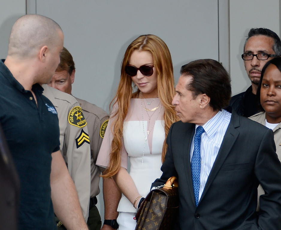 . LOS ANGELES, CA - MARCH 18:  Lindsay Lohan (C) and her lawyer Mark Heller (R) leave after Lohan\'s trial for allegedly lying to police after a car crash, reckless driving and violating her probation for a 2011 jewelry theft conviction at Airport Branch Courthouse of Los Angeles Superior Court March 18, 2013 in Los Angeles, California. Lohan pleaded no contest to two counts in a plea deal and sentenced to 90 days in locked rehab, 30 days community labor and 18 months psychotherapy.  (Photo by Kevork Djansezian/Getty Images)