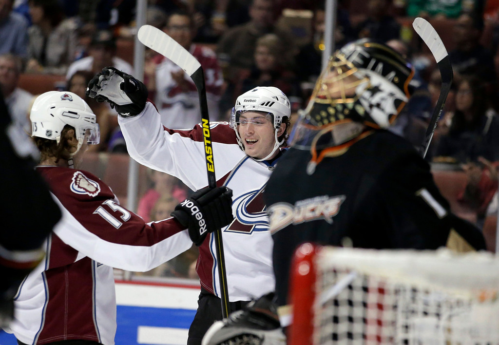 . Colorado Avalanche\'s John Mitchell, center, and P.A. Parenteau, left, celebrate Mitchell\'s goal against Anaheim Ducks goalie Jonas Hiller, foreground, of Switzerland, during the first period of an NHL hockey game in Anaheim, Calif., Wednesday, April 10, 2013. (AP Photo/Jae C. Hong)