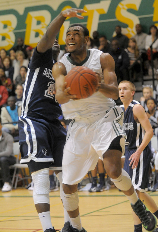 . 02-19-2012--(LANG Staff Photo by Sean Hiller)- Mayfair at Poly in the second round of the Division I-AA boys basketball playoffs Tuesday night. Mayfair\'s William English tries to stop Poly\'s Roschon Prince.