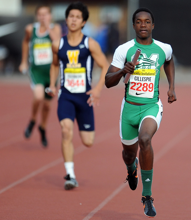 Description of . Monrovia's Carvon Gillespie runs the anchor leg of the 4x200 rated race during the Arcadia Invitational at Arcadia High School on Friday, April 5, 2013 in Arcadia, Calif.  (Keith Birmingham Pasadena Star-News)