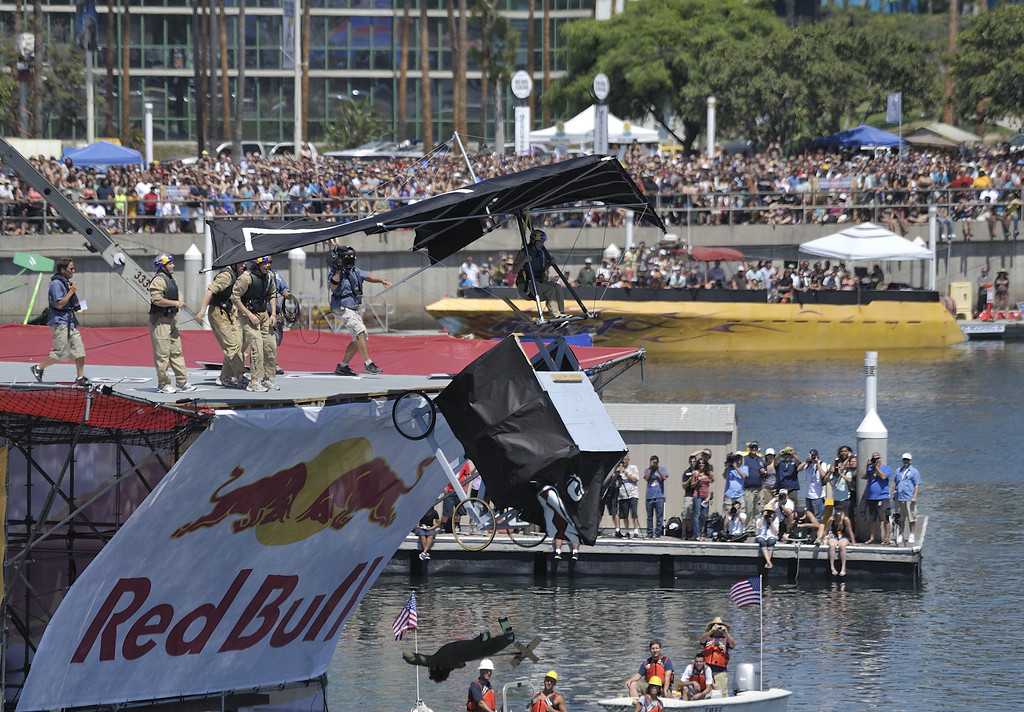 ". LONG BEACH, CALIF. USA -- Jennifer Day pilots ""Team Stealth Ginger\"" during the Flugtag in Rainbow Harbor in Long Beach, Calif. on August 21, 2010. Thirty five teams competed in the Red Bull event where teams build homemade, human-powered flying machines and pilot them off a 30-foot high deck in hopes of achieving flight.  Flugtag means \""flying day\"" in German. They are on distance, creativity and showmanship..Photo by Jeff Gritchen / Long Beach Press-Telegram.."