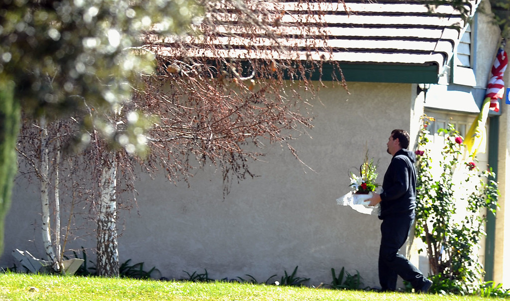 . Flowers are delivered at the home of slain Deputy Jeremiah MacKay where Redlands police and sheriff\'s deputies station themselves outside the home in Redlands, Calif on Wednesday February 13, 2013. MacKay, a San Bernardino County Sheriff\'s deputy, was shot and killed by the fired LAPD Officer Christopher Dorner in the mountains of San Bernardino National Forest where it\'s believed Dorner may have died after barricading himself in a cabin that later burned to the ground.