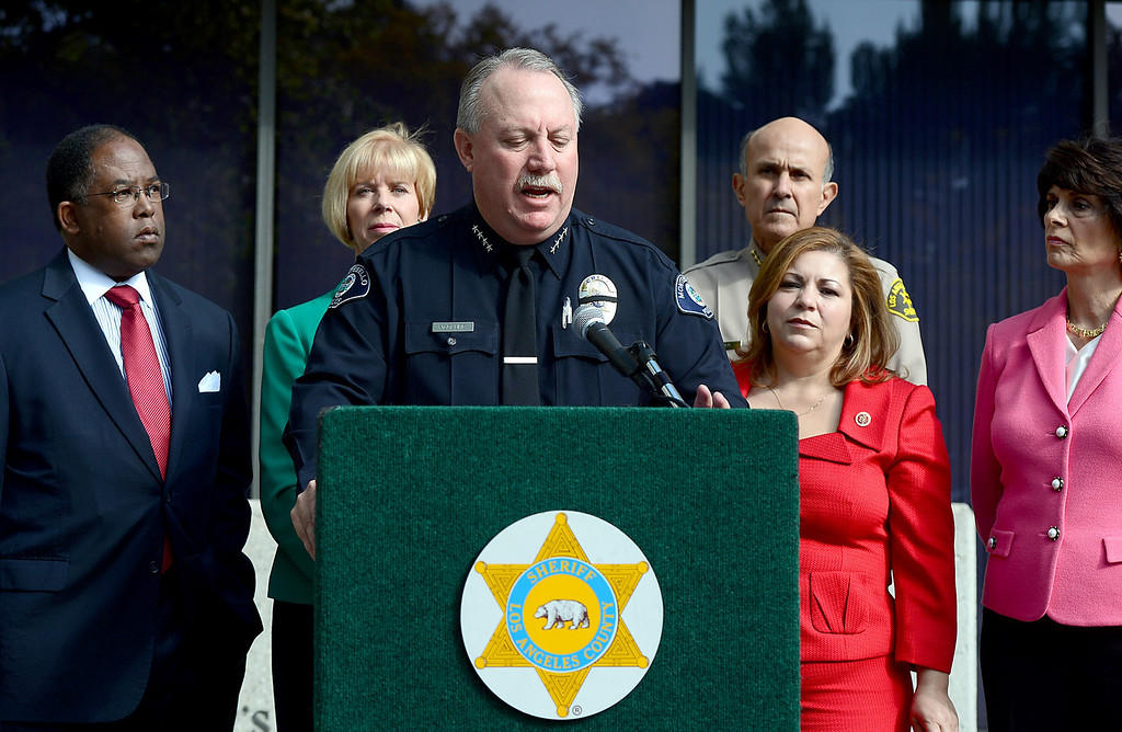 Description of . Montebello Police Chief Kevin McClure speaks to the press in support of Congresswoman Linda Sanchez' legislation to assist law enforcement with gun buyback programs Thursday, February 21, 2013 at Los Angeles County Sheriff's Headquarters. (SGVN/Staff Photo by Sarah Reingewirtz)
