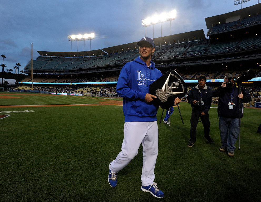. Clayton Kershaw walks off the field with his Cy Young Award before the game. The throphy was presented to him by Fernando Valenzuela. The Dodgers played host to the Pittsburgh Pirates in a game played at Dodger Stadium in Los Angeles, CA 4/11/2012(John McCoy/Staff Photographer)