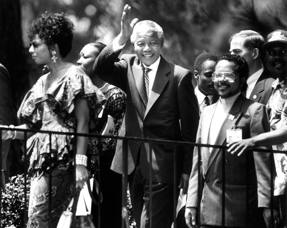 . July 1993: Nelson Mandela, president of the African National Congress, waves to well-wishers during a stop at First AME Church in Los Angeles.  Daily News file photo