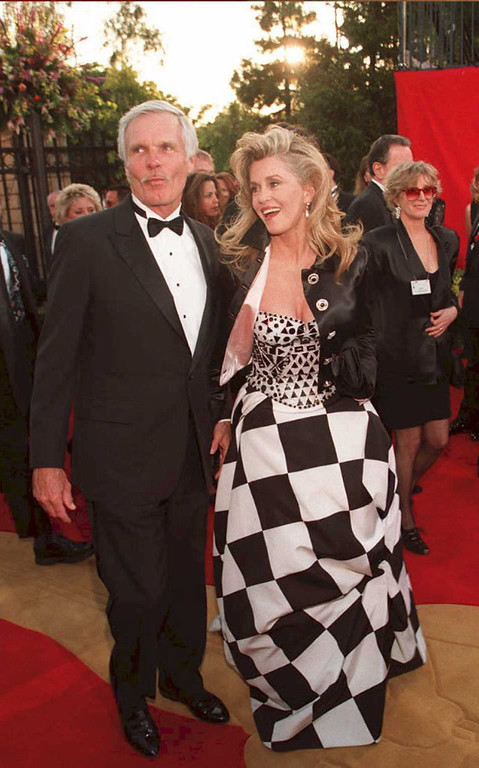 . LOS ANGELES, UNITED STATES:  US actress Jane Fonda (R) arrives with her husband Ted Turner 27 March for the 67th annual Academy Awards in Los Angeles. Fonda has won an Oscar for her film work and Turner is the head of Turner Enterprises.   AFP PHOTO (Vince Bucci/AFP/Getty Images)