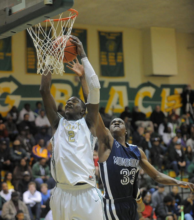 . 02-19-2012--(LANG Staff Photo by Sean Hiller)-Poly defeated Mayfair 73-28 in the second round of the Division I-AA boys basketball playoffs Tuesday night. Jordon Bell grans a rebound over Eze Egeonuigwe.