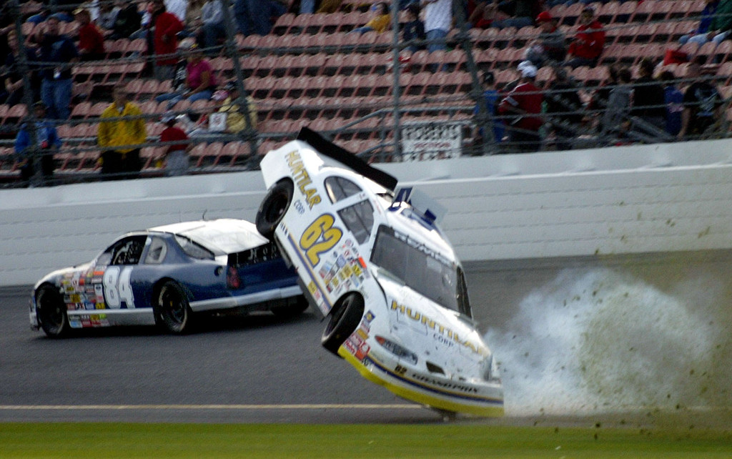 . ARCA driver Clair Zimmerman in the number 62 car goes airborne as he crashes during the NASCAR ARCA 200 race at Daytona International Speedway, Saturday, Feb. 12, 2005, in Daytona Beach, Fla., as Norm Benning in the number 84 car makes his way safely past. (AP Photo/Wilfredo Lee)
