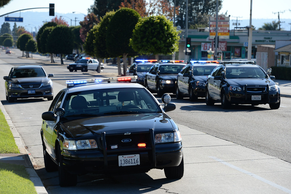 . A man allegedly shot an Inglewood police officer Wednesday, November 27, 2013, in Inglewood, CA, and the took hostages as he barricaded inside a house on S. 5th Avenue. Crenshaw Blvd. was closed for operations blocks from the incident. Photo by Steve McCrank/DailyBreeze