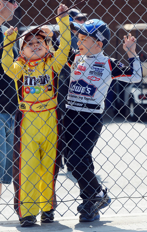 . 0323_NWS_IDB_L-ECONOMY-02-WL (Will Lester/Staff Photographer) NASCAR fan Evan Shortle (left), 4 from Seal Beach, wears the uniform of his favorite driver Kyle Busch while his older brother Easton, 5, sports a Jimmie Johnson uniform, while they wait for their favorite drivers to drive by Friday March 22, 2013 at Auto Club Speedway in Fontana.