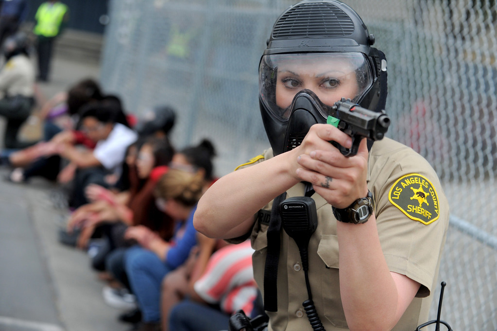 . 04-02-2013-(LANG Staff Photo by Sean Hiller)- The Cerritos Sheriff�s Station and the Los Angeles County Fire Department conducted an active shooter response drill at Gahr High School in Cerritos Tuesday. Deputy Suzette Madrid participates in the drill that used live gunfire and explosives.