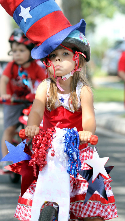 . July 4, 2013-Photo by Tracey Roman/for the Press-Telegram  Gabriela Hicks, 3 1/2, of Los Altos participates in the annual 4th of July bike parade in the Los Altos neighborhood of Long Beach.