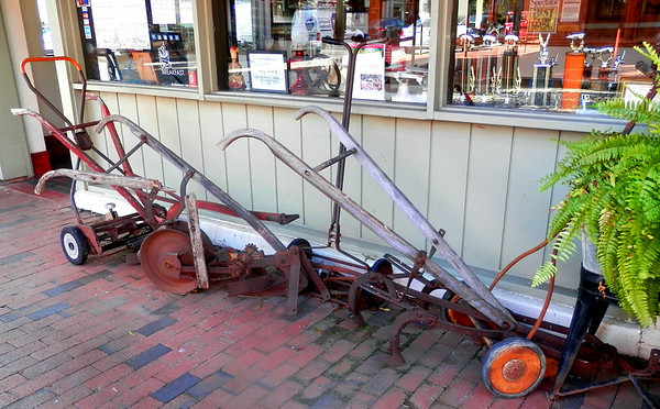 Some of Big Ed's historic plows in front of the restaurant.