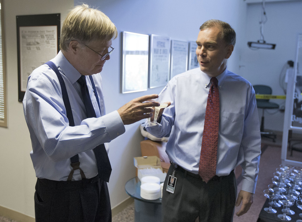 . Tim Nickens, right, and Dan Ruth toast each other after they won the Pulitzer Prize for editorial writing Monday, April 15, 2013, in St. Petersburg, Fla. The pair won for their series of editorials on Pinellas County\'s decision to fluoridate resident\'s water. (AP Photo/Chris O\'Meara)