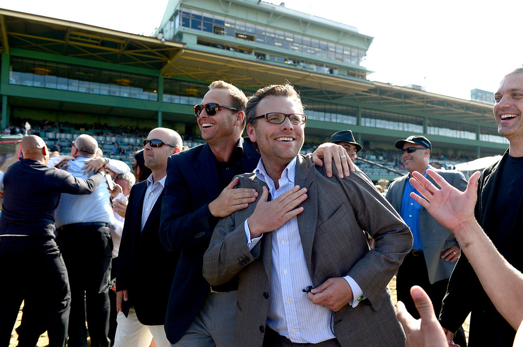 Description of . Friends and family celebrate Goldencents Santa Anita Derby win Saturday, April 6, 2013 at Santa Anita Park in Arcadia. Goldencents will now race in the Kentucky Derby. (SGVN/Staff Photo by Sarah Reingewirtz)