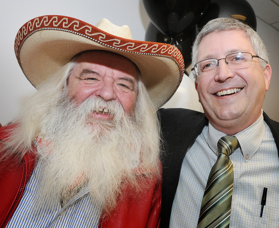 . San Marino\'s Swedish cowboy barber Jann Eldnor, aka Jann of Sweden, with Frank Girardot, Editor of the Pasadena Star-News celebrate at opening of Star-News Lounge. After a nearly 130-year relationship with Pasadena, the Star-News renewed its vows of serving the community Tuesday at the grand opening of the Star-News Lounge March 13, 2013. (SGVN/Photo by Walt Mancini/SXCity)