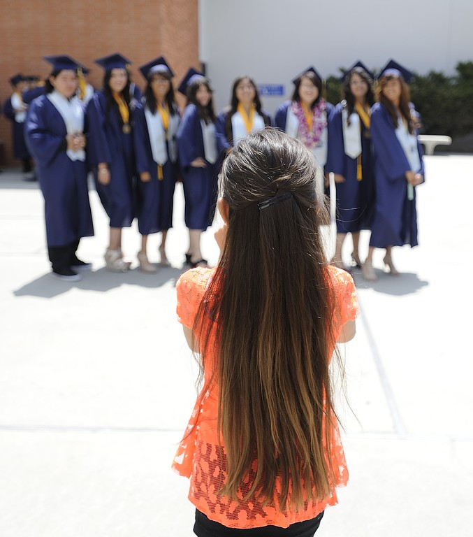 . TORRANCE, CALIF. USA -- Graduates pose for pictures before commencement ceremonies for Lennox Math, Science & Technology Academy at El Camino College in Torrance, Calif., on June 8, 2013.   Photo by Jeff Gritchen / Los Angeles Newspaper Group