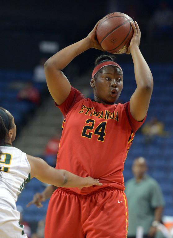 . Etiwanda\'s Amy Okonkwo looks for an open player at Citizens Business Bank Arena in Ontario, CA on Saturday, March 22, 2014. Long Beach Poly vs Etiwanda in the CIF girls open division regional final. 2nd half, Poly won 56-46. Photo by Scott Varley, Daily Breeze)
