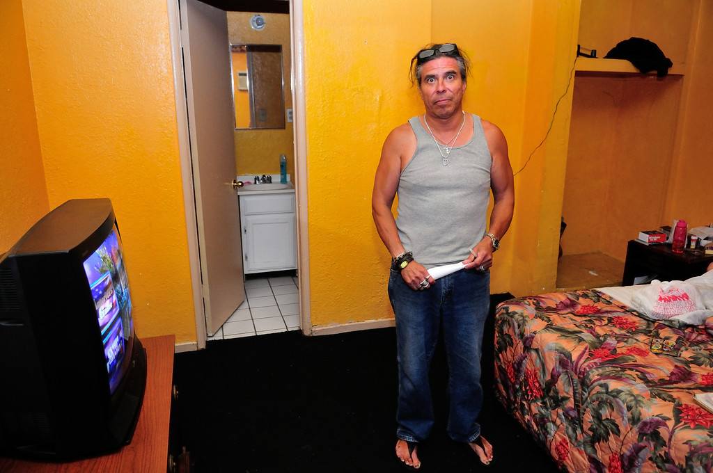 . Tim Grobaty fan, Aldred Esquivel, in his girlfriend\'s room at the El Capitan Motor Inn. Photo by Thomas Wasper for the Press Telegram