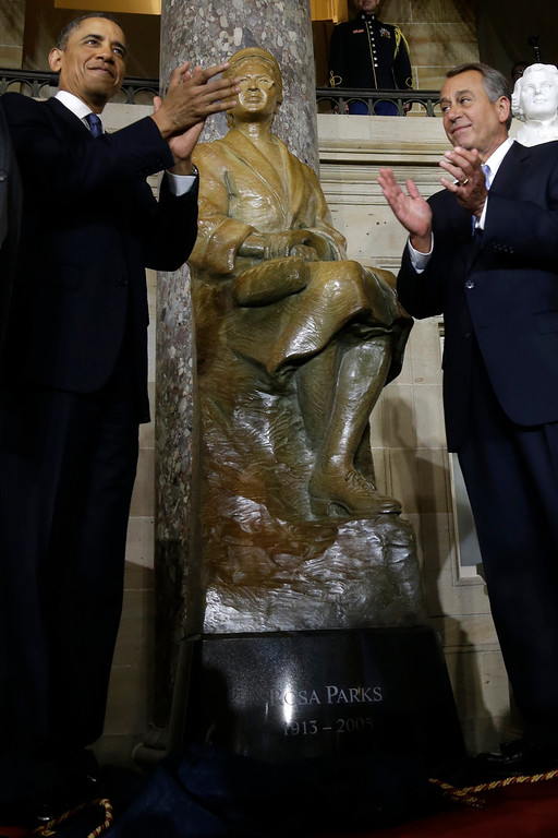 Description of . President Barack Obama and House Speaker John Boehner of Ohio applaud at the unveiling of a statue of Rosa Parks, Wednesday, Feb. 27, 2013, on Capitol Hill in Washington.  (AP Photo/Charles Dharapak)